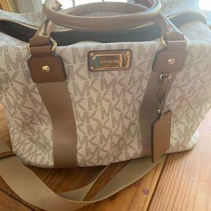 Brand new brown and white Michael Kors travel bag